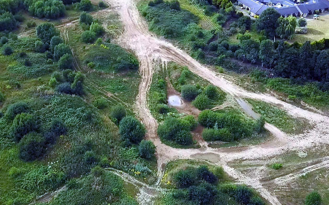 Drone aerial view off roading Dirt Track site in St Albans Bricket Wood